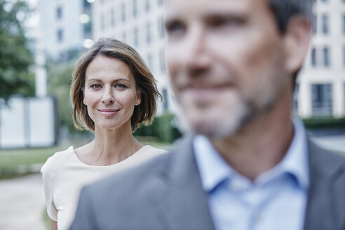 Portrait of confident businesswoman and businessman outdoors - RORF00916
