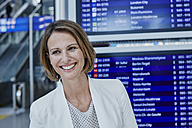 Happy businesswoman at timetable at the airport - RORF00940