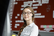 Portait of young woman in office wearing headset - PESF00719