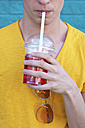 Young man drinking soft drink, partial view - RTBF00918