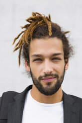 Portrait of young businessman with dreadlocks - MGIF00030