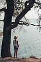 Greece, Chalkidiki, young woman looking at the sea - BZF00372