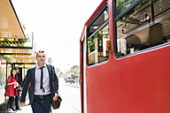 Businessman trying to catch the tram - HAPF01752