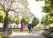 Businessman and businesswoman meeting in city park - HAPF01758