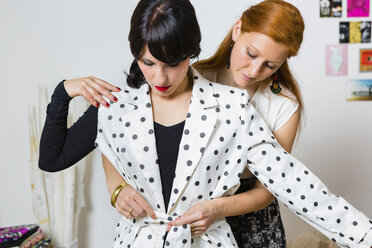 Fashion designer with client in studio - MGIF00045