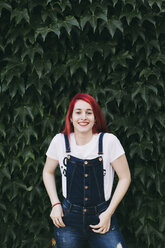 Portrait of redhead woman wearing dungarees - JPF00244
