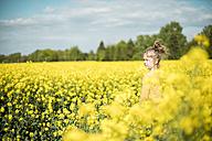 Girl standing in rape field - MOEF00014