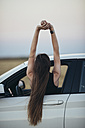 Woman leaning out of car window - JPF00245