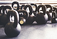 Kettlebells on floor in gym - HAPF01796