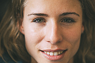 Portrait of smiling young woman - KNSF01677