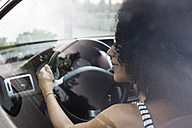 Woman driving car - ABZF02167