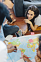 Group of friends planning vacation together - GIOF02811