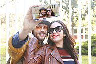 Happy young couple taking selfie with smartphone - RTBF00937