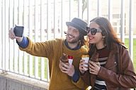Young couple taking selfie with cell phone - RTBF00940