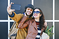Happy young couple taking selfie with smartphone - RTBF00946