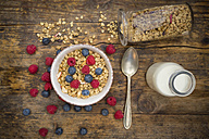 Bowl of granola with raspberries and blueberries - LVF06201