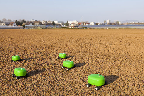 Five agricultural robots on a field - WDF04049