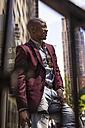 USA, New York City, Manhattan, smiling businessman - MAUF01124