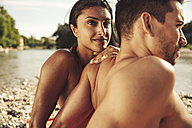 Couple relaxing on the beach - SUF00156