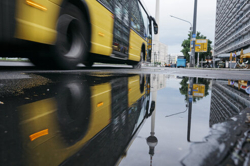 Germany, Berlin, Berlin TV Tower reflecting in puddle after rain - ZMF00483