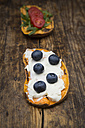 Toasted sweet potato slice garnished with cream cheese and blueberries - LVF06211