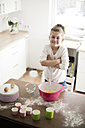 Portrait of smiling little girl baking in the kitchen - MOEF00034