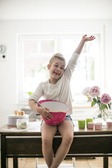 Proud little girl baking in the kitchen - MOEF00037