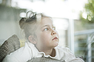 Portrait of serious little girl looking out of window - MOEF00058