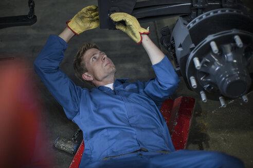 Industrial worker screwing in bolt - ZEF14061