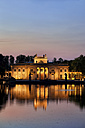 Poland, Warsaw, Royal Lazienki Park, Palace on the Isle at twilight with reflection on water - ABOF00214