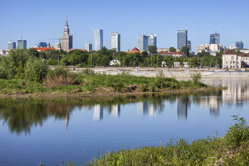 Poland, Warsaw, city center skyline from the bank of the Vistula River - ABOF00238