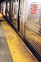 USA, New York City, subway station platform with driving underground train - MAUF01156