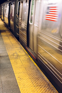 USA, New York City, subway station platform with driving underground train - MAUF01156