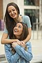Girlfriends having fun, laughing and hugging - CHAF01898