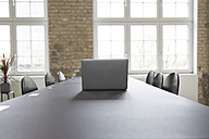 Laptop on conference table - RBF05749