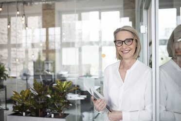 Mature businesswoman holding digital tablet - RBF05782