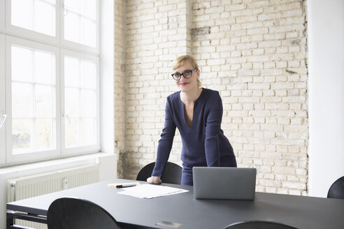 Successful businesswoman standing in her office - RBF05827