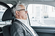 Senior businessman sitting in car with closed eyes - GUSF00015