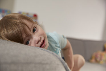 Portrait of little boy lying on couch - SUF00234