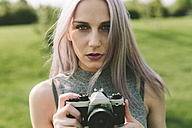 Young woman taking pictures with camera in nature - GIOF02903