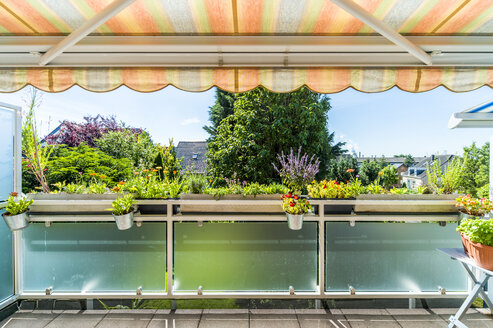 Flowers on balcony with awning - FRF00527