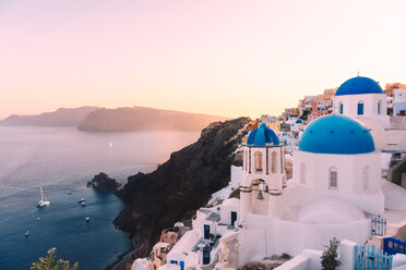 Greece, Santorini, Oia, view to caldera and Greek Orthodox Church at sunset - GEMF01727