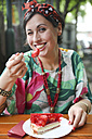 Woman eating strawberry cake in street cafe - RTBF00991
