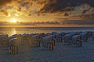 Germany, Mecklenburg-Western Pomerania, Baltic sea seaside resort Sellin, Hooded beach chairs on the beach - GFF00990