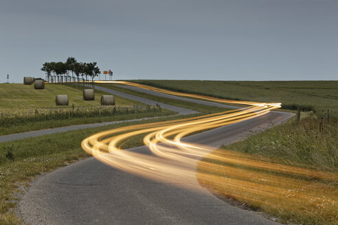 Germany, Mecklenburg-Western Pomerania, Rugen, light trails on road near Kap Arkona - GFF01014