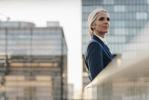 Businesswoman standing on bridge - KNSF01796