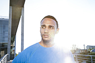 Portrait of confident athlete in the city - FKF02438