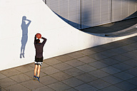 Young man playing basketball in the city - FKF02441