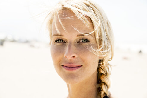 Portrait of blond woman outdoors - FMKF04235