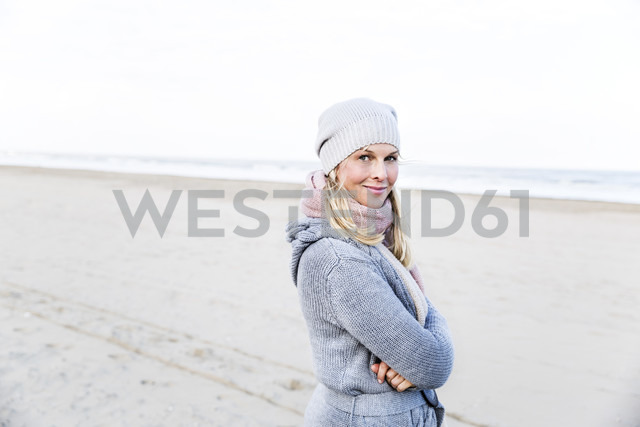 Portrait of smiling woman on the beach - FMKF04271